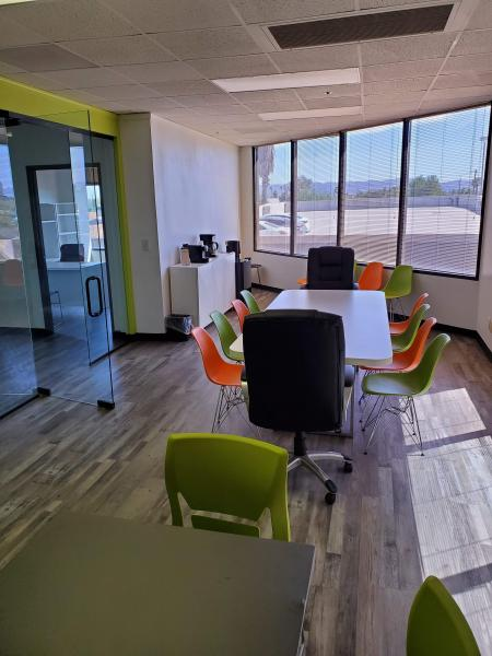Here's our Conference Room, where we hold staff meetings, group supervisions, and any meetings with groups of external stakeholders.